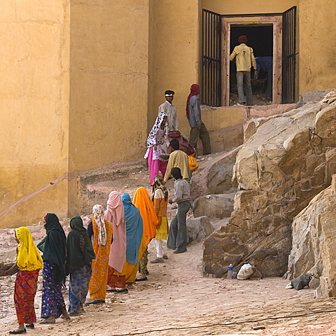 Men and women working on the restoration of the Amber Fort, Jaipur, Rajasthan, India.