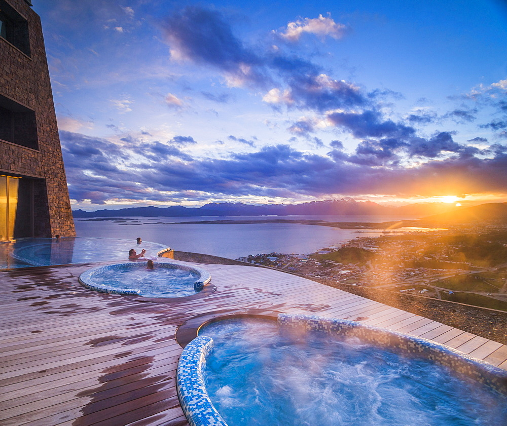 Outdoor swimming pool and jacuzzi at sunset, Hotel Arakur Ushuaia Resort and Spa, Ushuaia, Tierra del Fuego, Patagonia, Argentina, South America