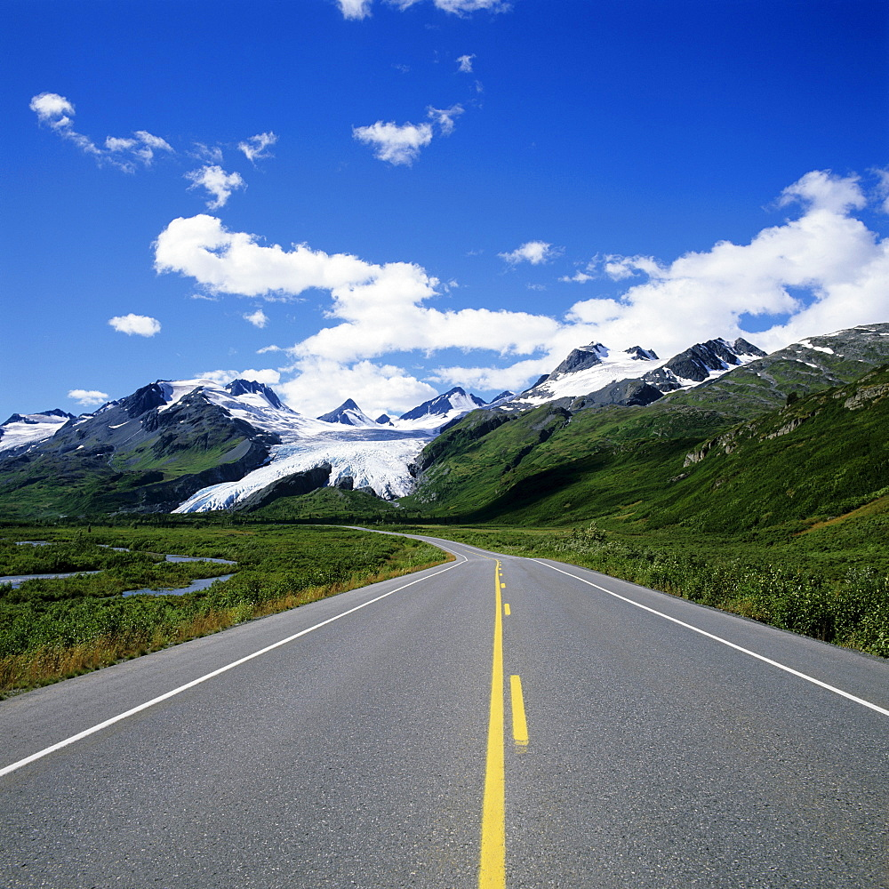 Alaska, Richardson Highway leading to Worthington Glacier, Blue skies and mountain peaks in distance .