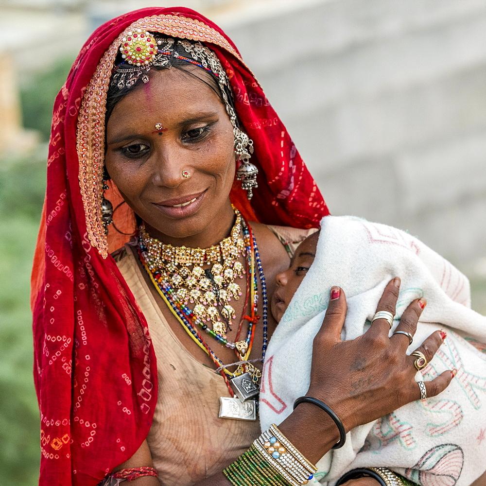 A mother holding her sleepy baby, Jaisalmer, Rajasthan, India