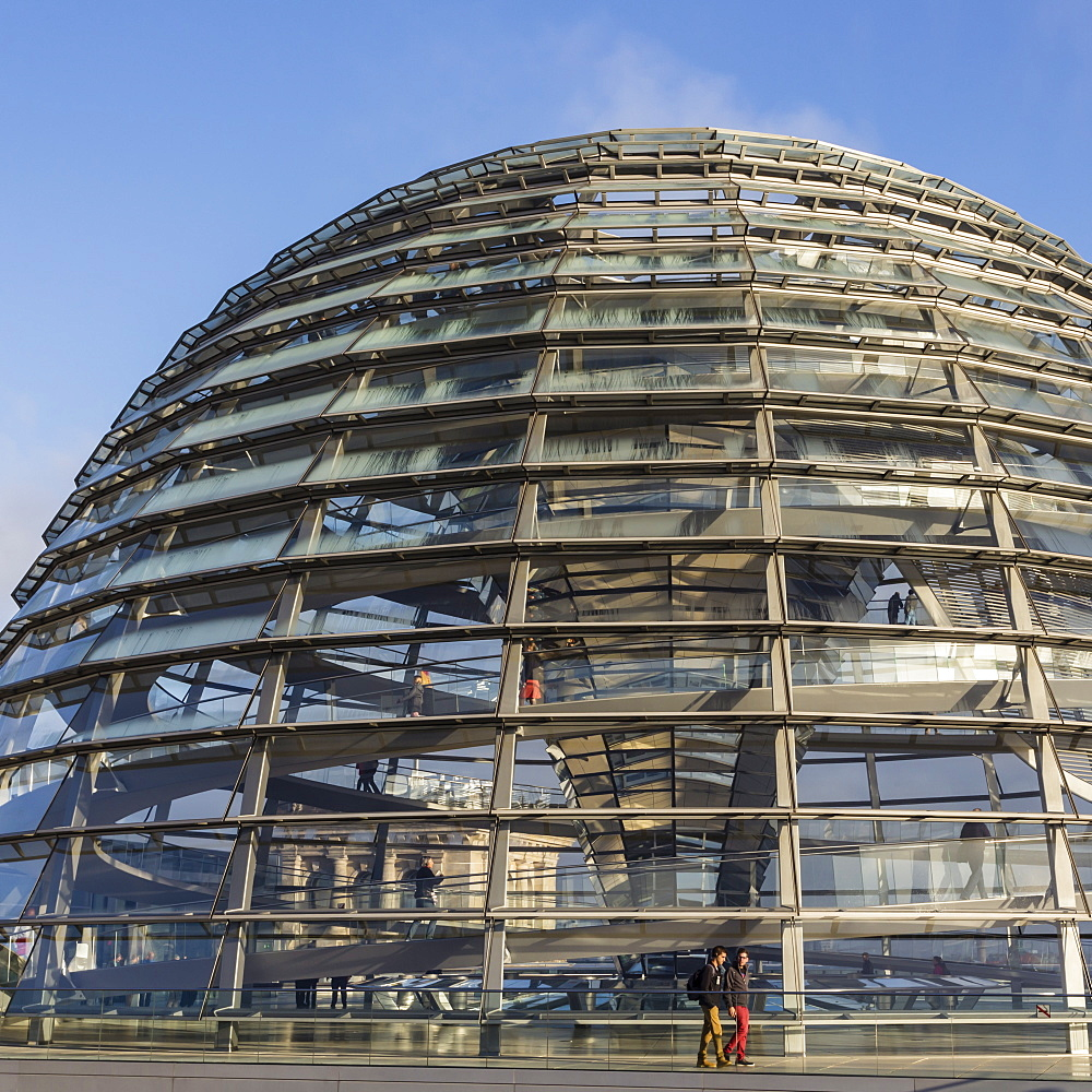 Reichstag dome exterior from its rooftop terrace, with passing visitors, early morning, Mitte, Berlin, Germany, Europe