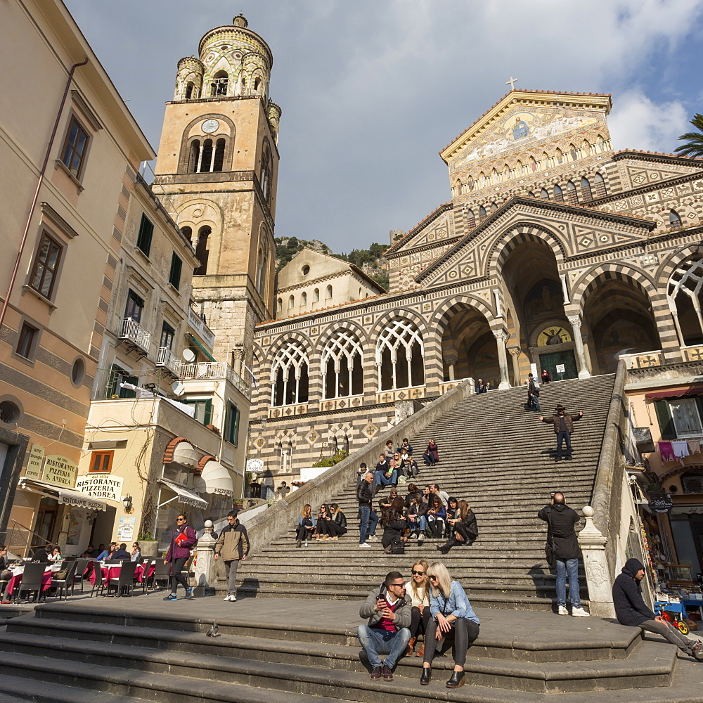 People in the sun on cathedral steps in spring, Amalfi, Costiera Amalfitana (Amalfi Coast), UNESCO World Heritage Site, Campania, Italy, Europe