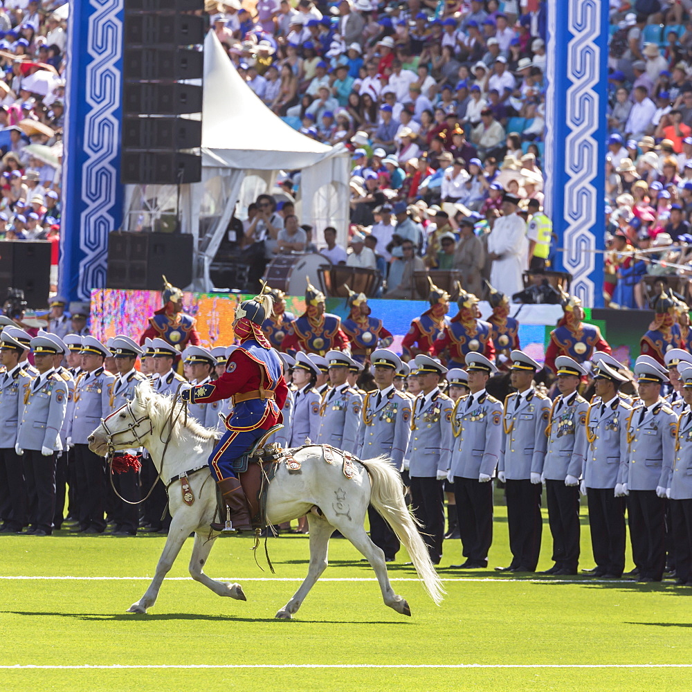 Horseman rides past rows of soldiers, Naadam Stadium, Naadam Festival Opening Ceremony, Ulaan Baatar (Ulan Bator), Mongolia, Central Asia,. Asia