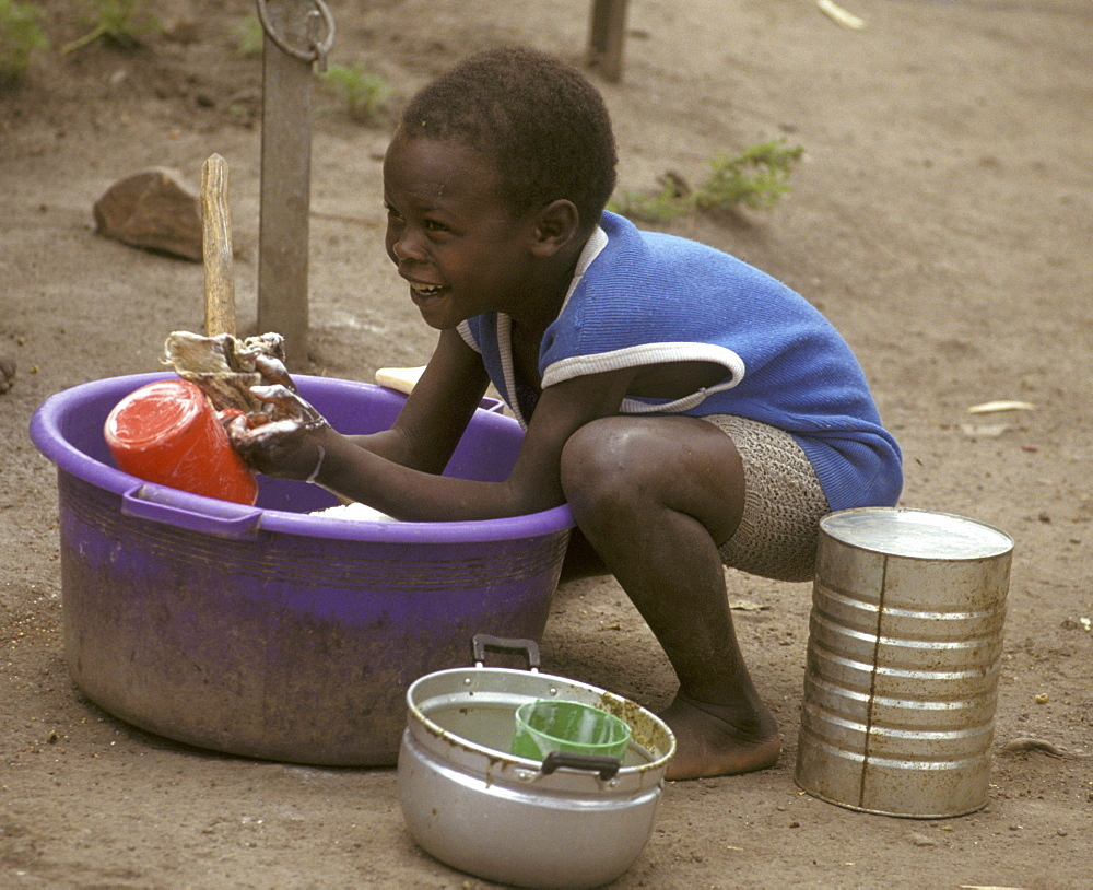 Rwanda boy washing dishes, mwisale