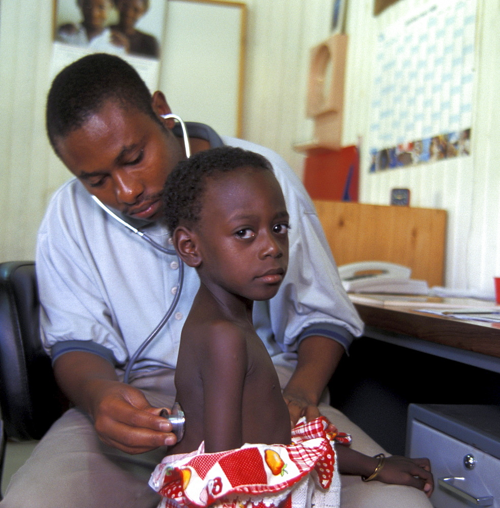 Tanzania doctor examining child at the posada clinic, dar-es-salaam.