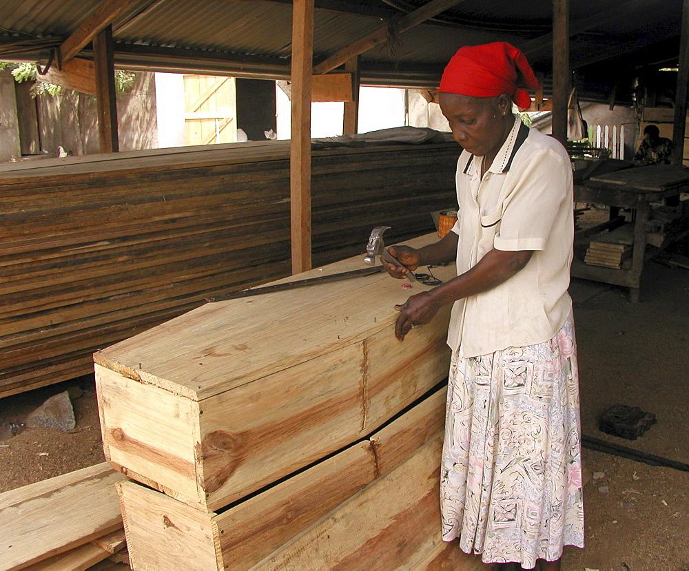 Woman making coffins, tanzania. Musoma