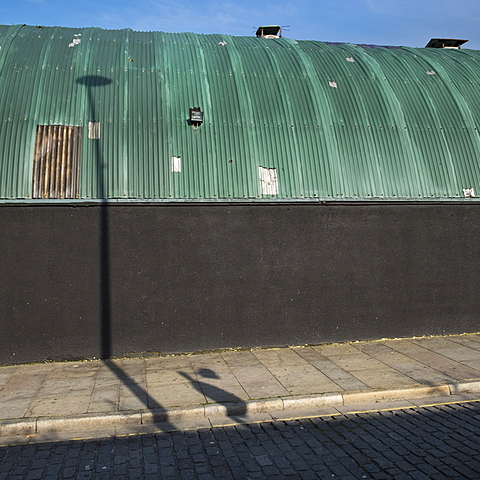 Shadows from street lights fall across a green corrugated roof of the Cream Nation Nightclub, Wolstenholme Square, Liverpool, Merseyside, England, United Kingdom, Europe