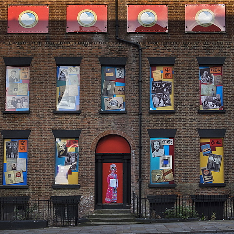 A row of terraced houses in Duke Street forming the backdrop for a unique public art work celebrating Chinese culture, Liverpool, Merseyside, England, United Kingdom, Europe