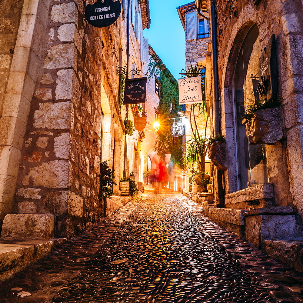 Narrow alleyway in Saint-Paul-de-Vence, Cote d'Azur, France. The city is famous for its art galleries