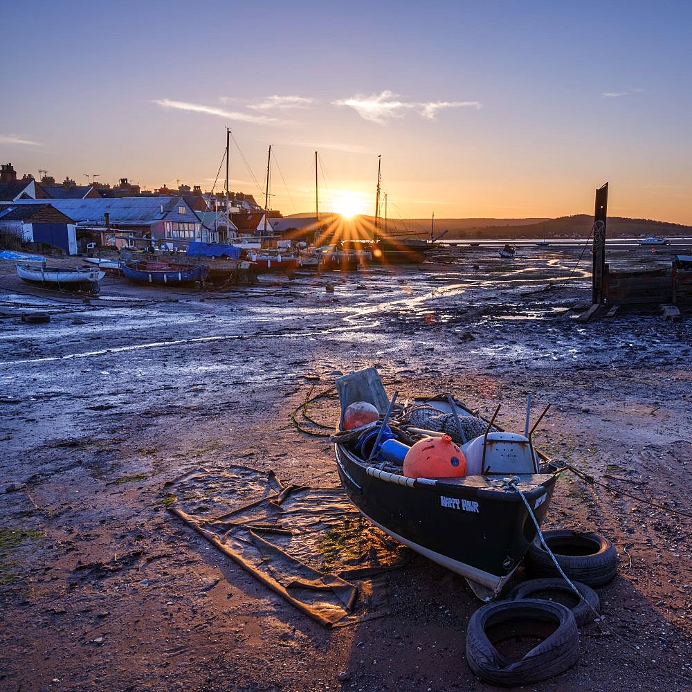 The sun sets behind the boats at Camperdown, Exmouth, Devon , UK - 1295-193