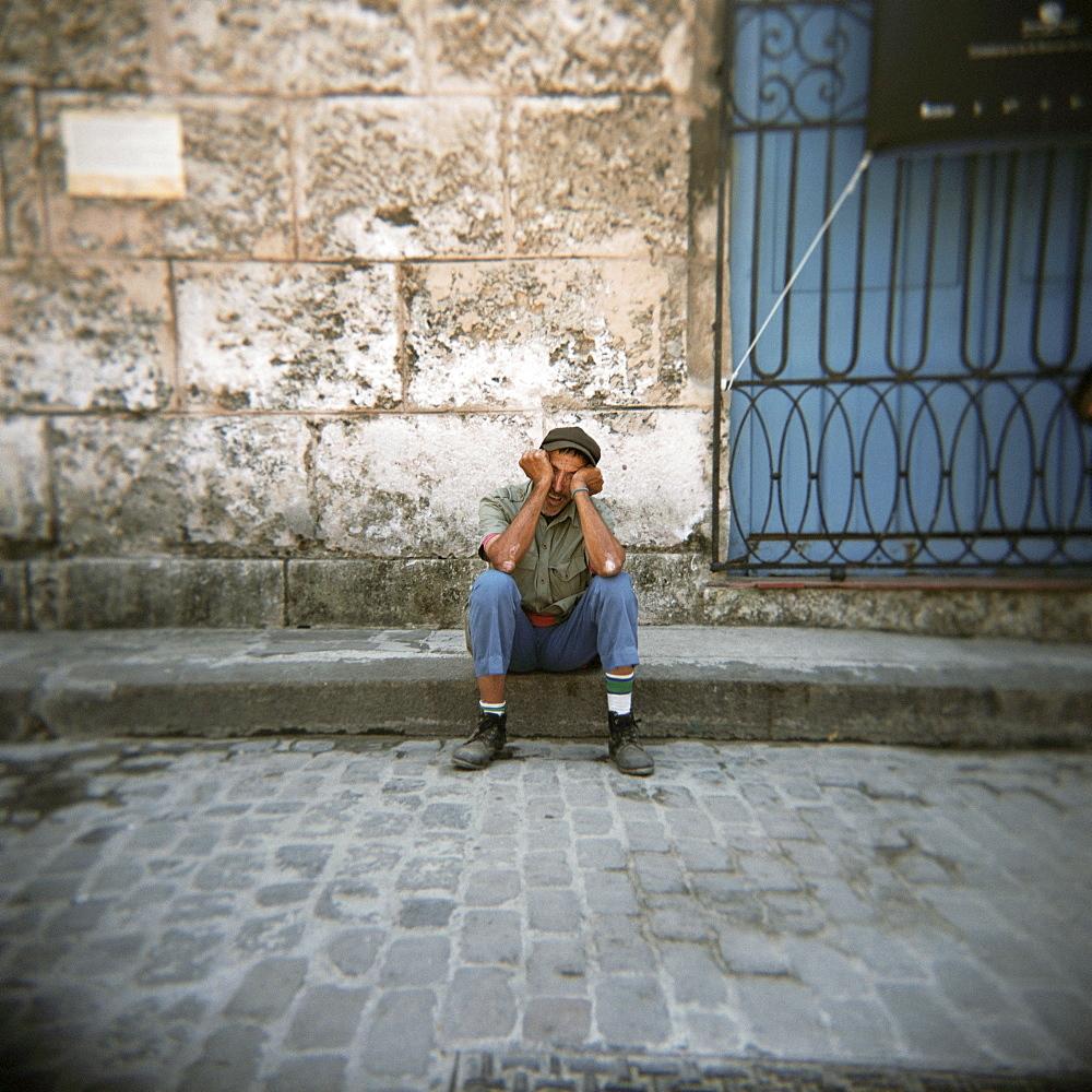 Man sleeping, Plaza Viejo, Havana, Cuba, West Indies, Central America
