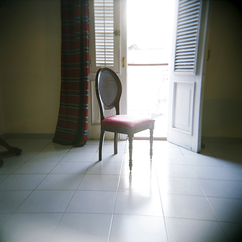 Chair in front of window, Hotel La Union, Cienfuegos, Cuba, West Indies, Central America