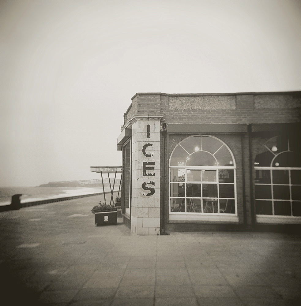 Image taken with a Holga medium format 120 film toy camera of ices sign on side of old Rendezvous Cafe on dull winter's day, Whitley Bay, Tyne & Wear, England, United Kingdom, Europe