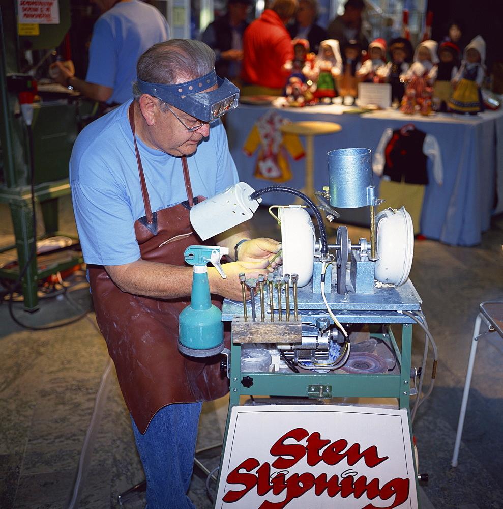 Man polishing semi-precious stones, Gallerian shopping mall, Stockholm, Sweden, Scandinavia, Europe - 391-4742