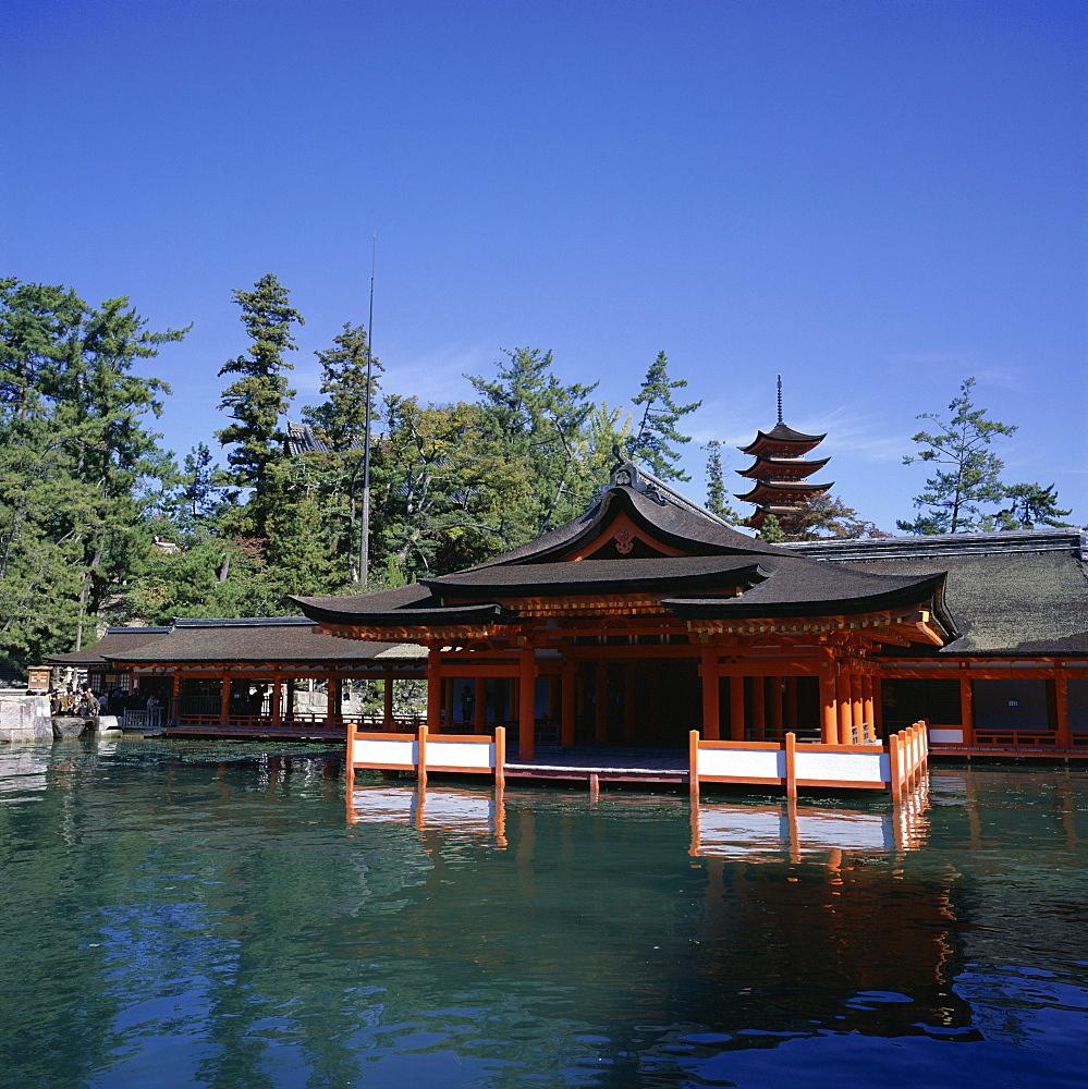 Itsukushima-jinja shrine and five storeyed pagoda, dating from 1407, Miya-Jima Island, Miya-Jima, Honshu, Japan, Asia