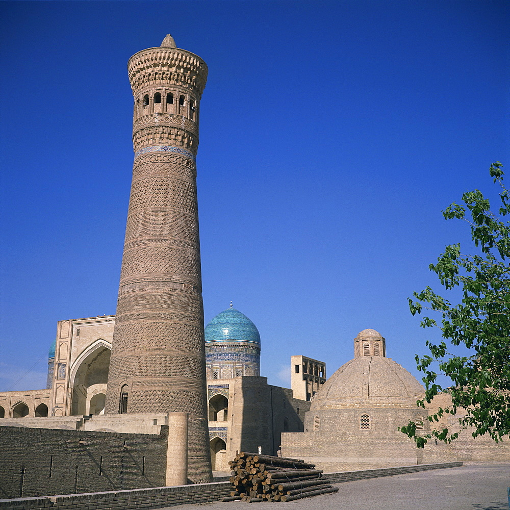 The Tower of Death or Kalyan minaret dating from 1127, and the Poi Kalyan Madrasah, dating from the 12th to 19th centuries, Bukhara, Uzbekistan, Central Asia, Asia
