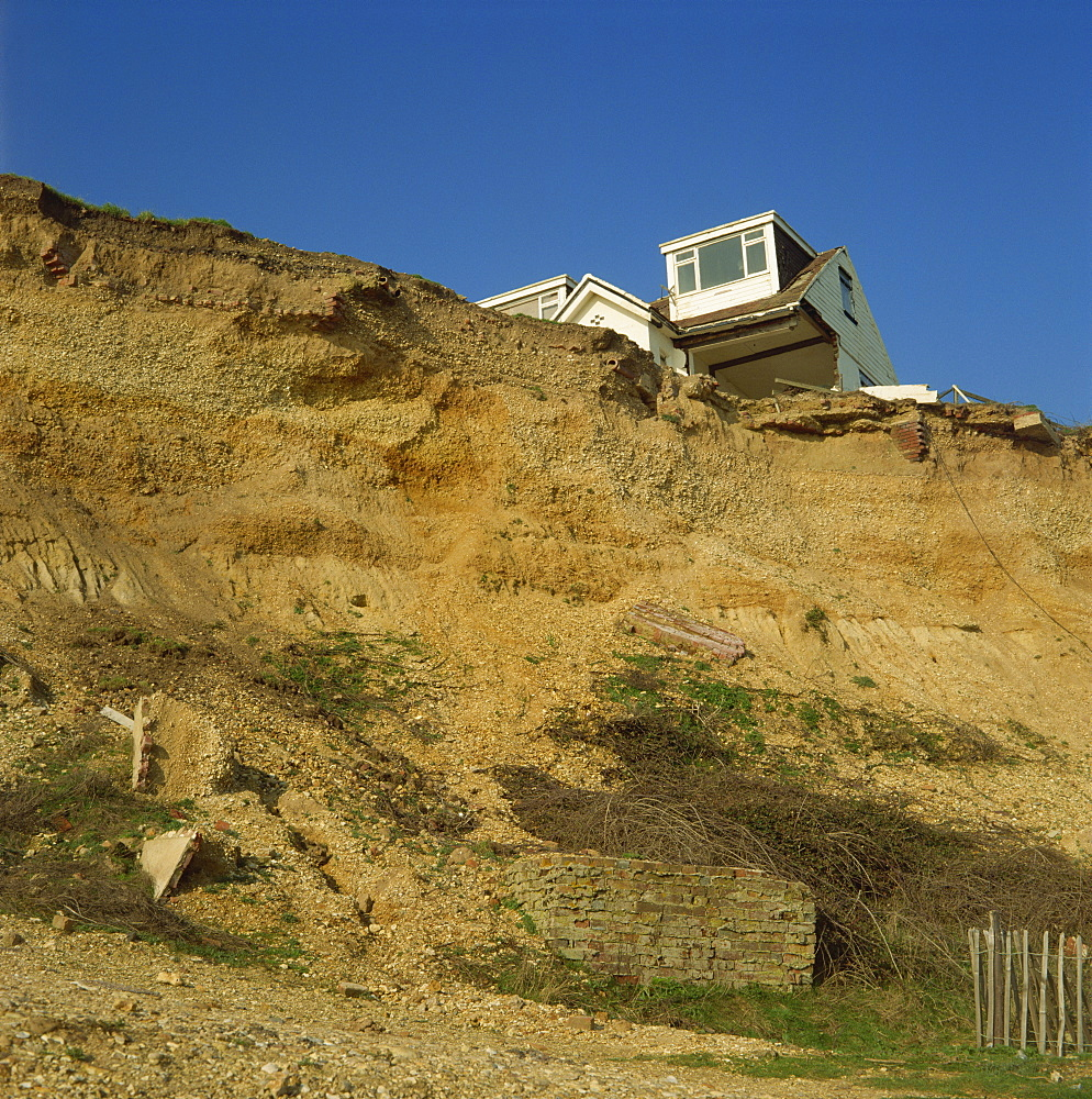 House about to topple over cliffs, Barton-on-Sea, Hampshire, England, United Kingdom, Europe