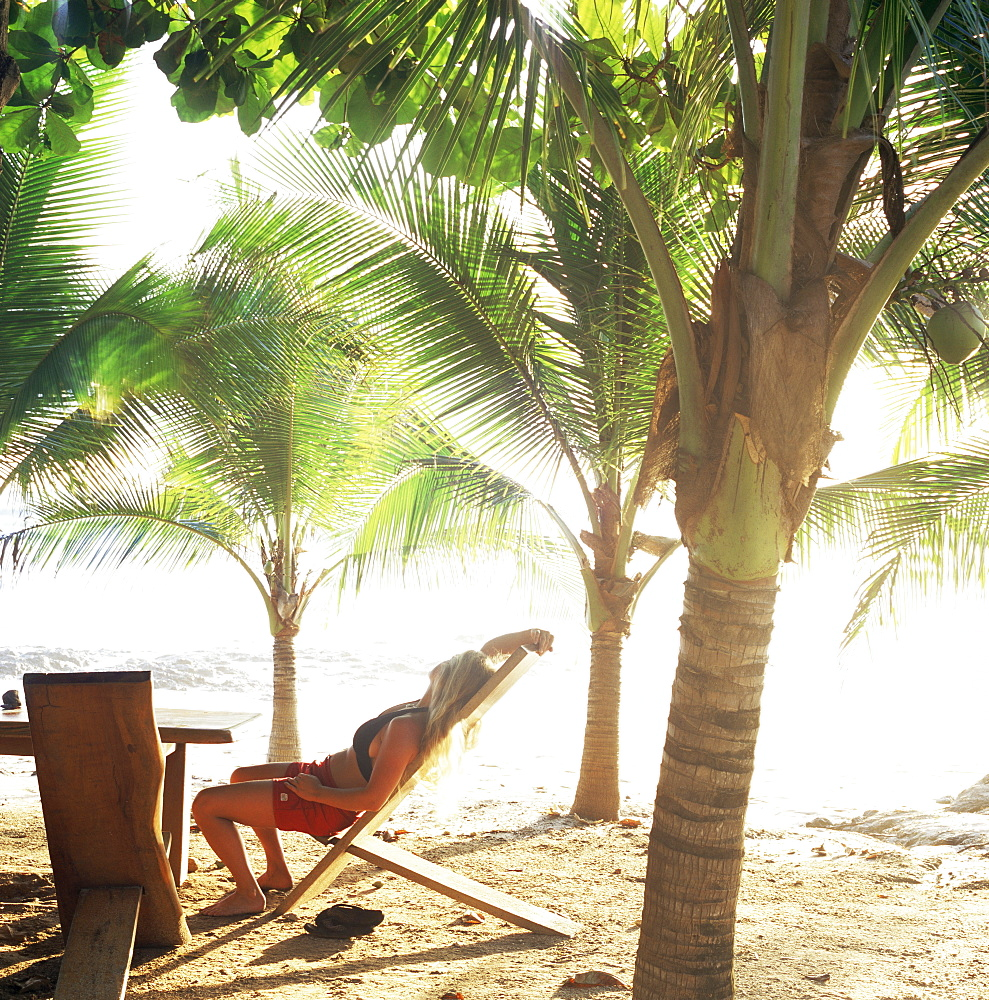 Young woman relaxes on Avellans Beach, Costa Rica, Central America - 753-146