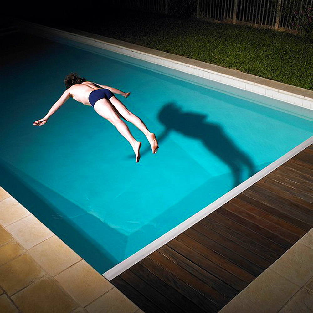Man diving in swimming pool