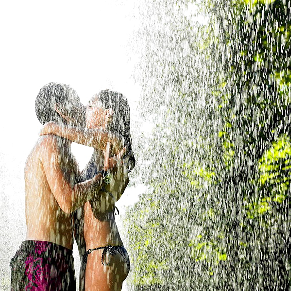 Couple kissing under a water jet, Couple kissing under a water jet