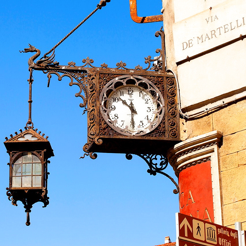Clock and street lamp, Via de Martelli, Piazza del Duomo, Florence, Tuscany, Italy, Europe.