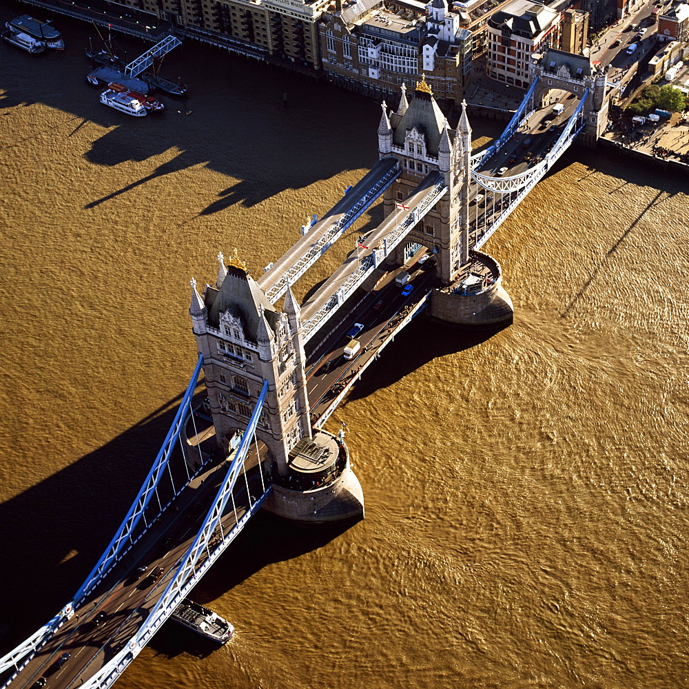 Aerial image of Tower Bridge, a combined bascule and suspension bridge, over the River Thames, London, England, United Kingdom, Europe - 823-187