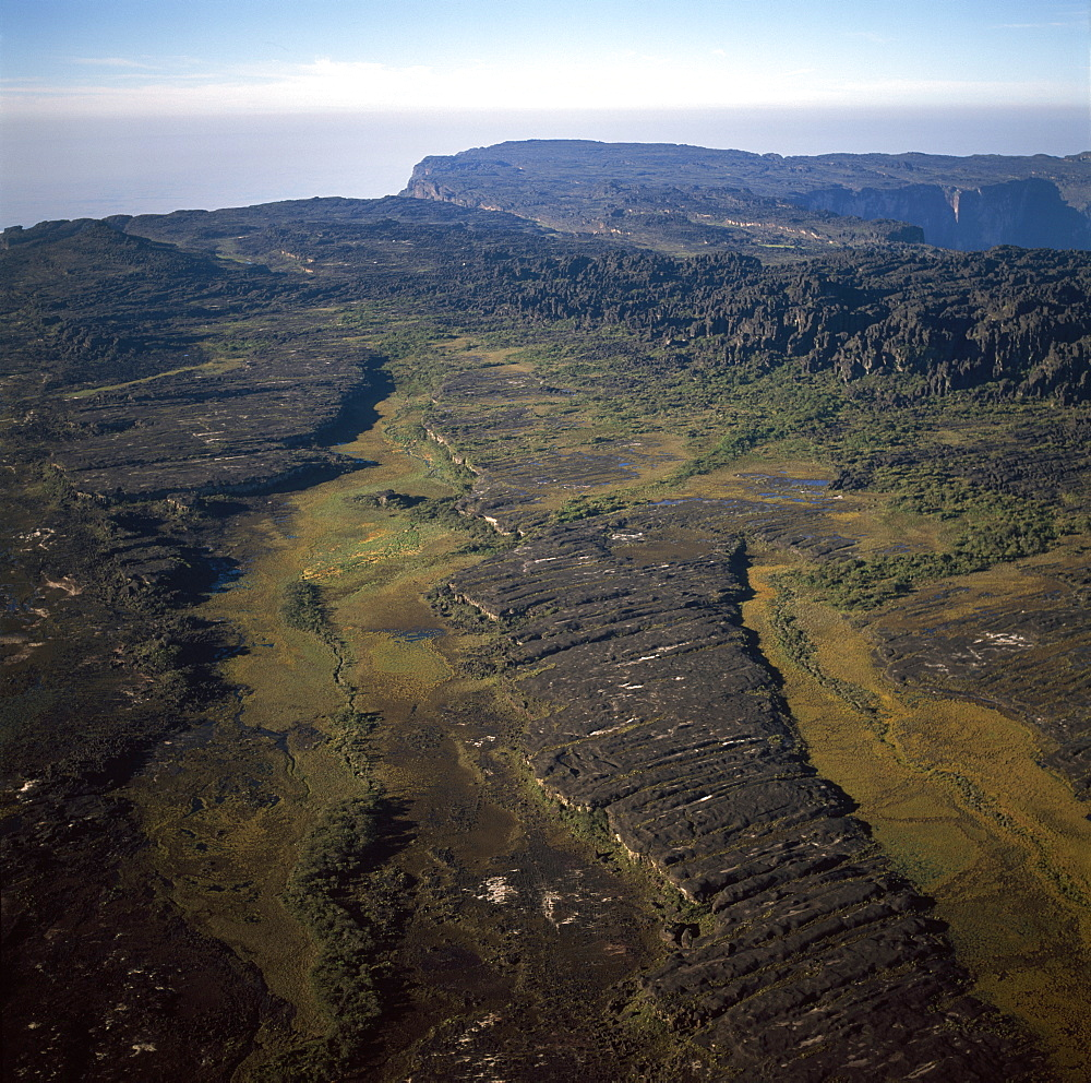 Aerial image of tepuis showing swamps and rock labyrinths on summit plateau in Brazilian and Guyanese sectors, Mount Roraima, Venezuela, South America