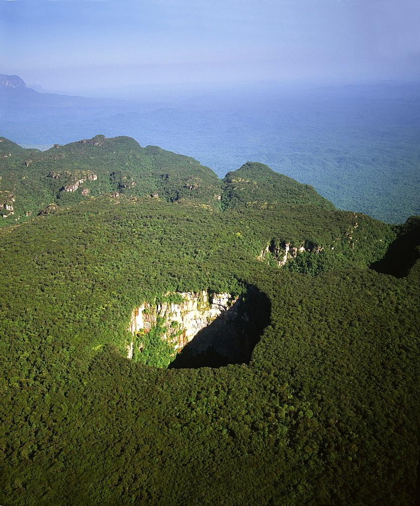 Aerial image of tepuis and Sarisarinama Sinkhole, Jaua-Sarisarinama National Park, Bolivar State, Venezuela, South America