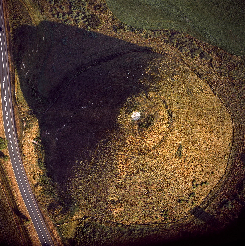 Aerial image of Silbury Hill, a prehistoric human-made chalk and clay mound near Avebury, UNESCO World Heritage Site, Wiltshire, England, United Kingdom, Europe