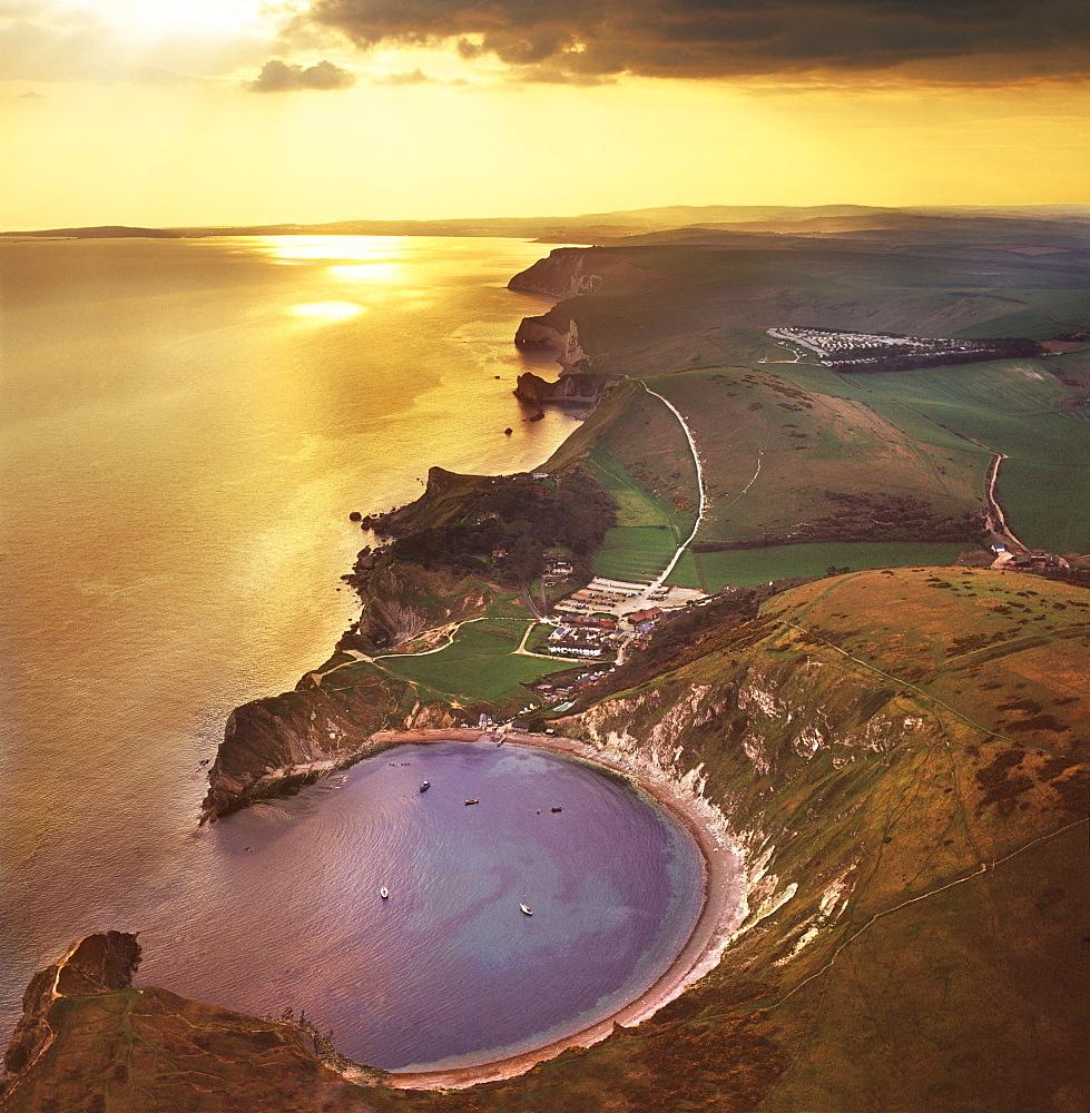 Aerial image of Lulworth Cove, a natural landform harbour, near West Lulworth, on the Jurassic Coast, UNESCO World Heritage Site, Dorset, England, United Kingdom, Europe