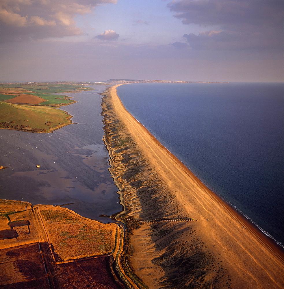 Aerial image of Chesil Beach (Chesil Bank), 29 km long shingle beach, a tombolo connecting mainland to the Isle of Portland, Jurassic Coast, UNESCO World Heritage Site, Dorset, England, United Kingdom, Europe