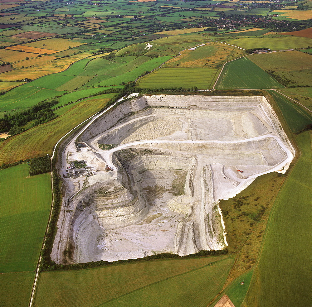 Aerial image of Westbury chalk quarry, with Westbury White Horse and Bratton Camp Hill Fort in background, Wiltshire, England, United Kingdom, Europe