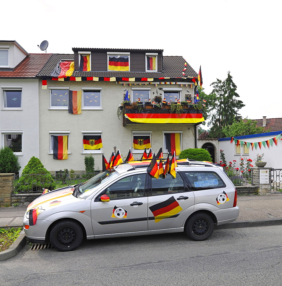 House and car decorated with German flags during Football World Cup 2010, Stuttgart, Baden-Wuerttemberg, Germany, Europe