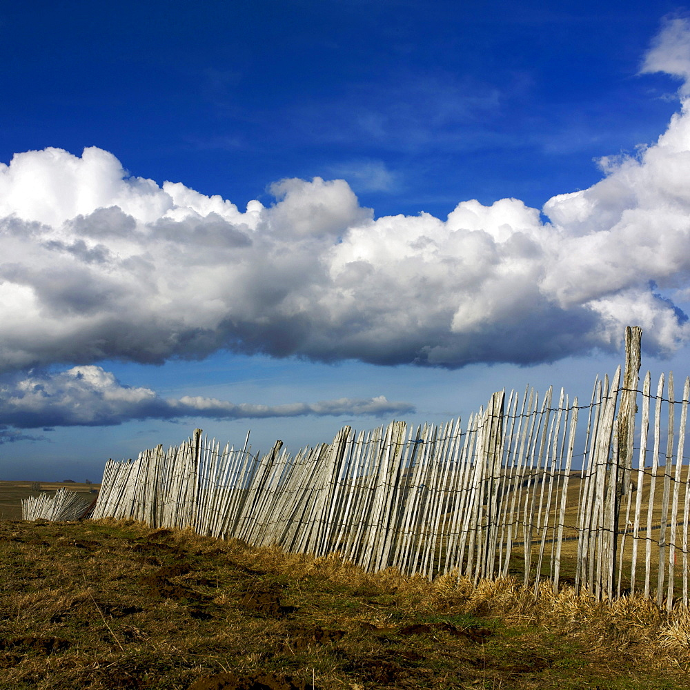 Fence in the rolling hills in Cezallier, Auvergne, France, Europe