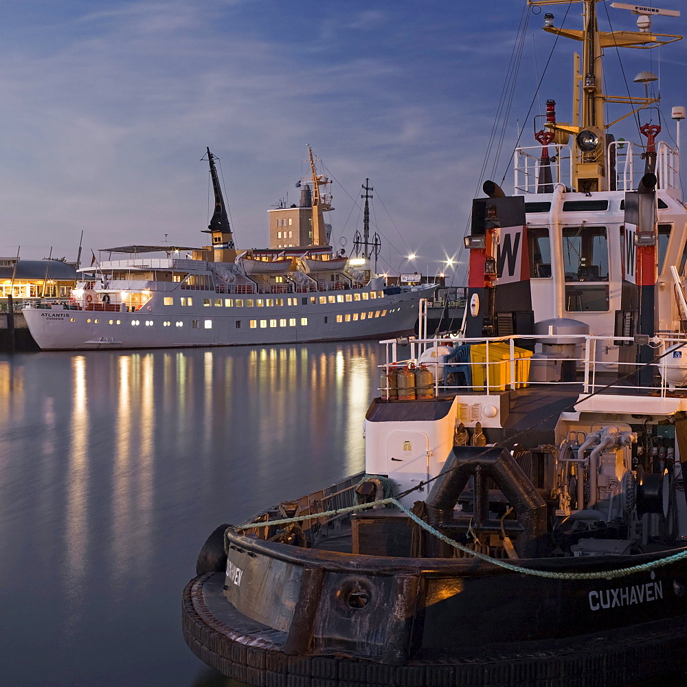Cruise liner, Atlantis, and tugboat, Taucher O. Wulf 3, at Alte Liebe pier in Cuxhaven, Lower Saxony, Germany, Europe