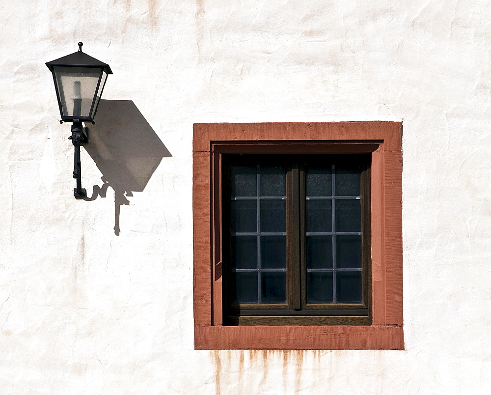 Window and lantern on the facade of a house, Wuerzburg, Bavaria, Germany, Europe