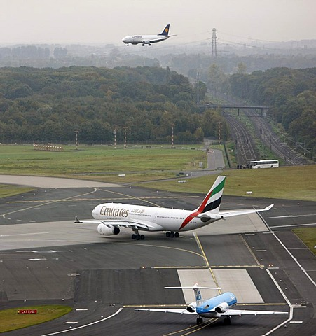 Duesseldorf International Airport, Emirates Airbus A330 on the taxiway to the runway, followed by KLM Cityhopper Fokker 70, Boeing 737, landing in Duesseldorf, North Rhine-Westphalia, Germany, Europe