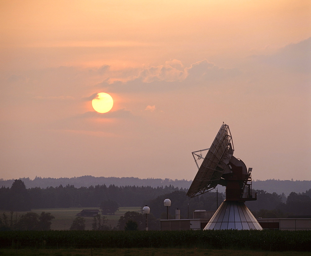 Sun at dusk, antennas of the ground communication station Raisting, Upper Bavaria, Germany