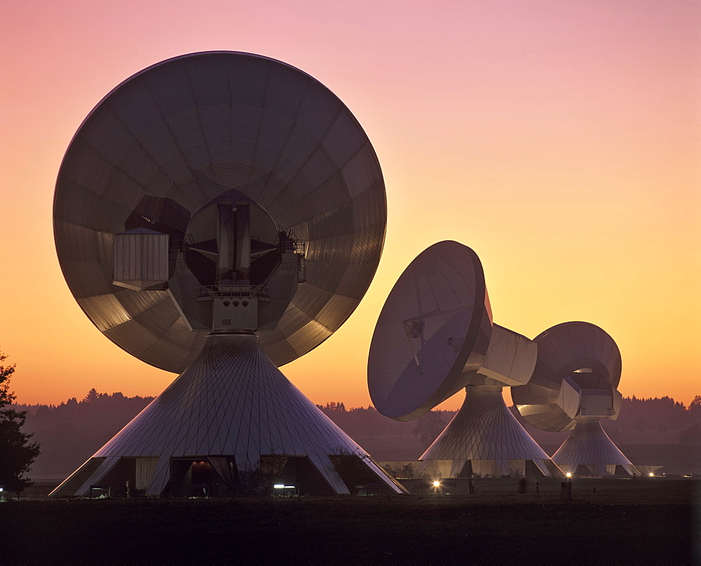 Dusk, lit antennas of the ground communication station Raisting, Upper Bavaria, Germany
