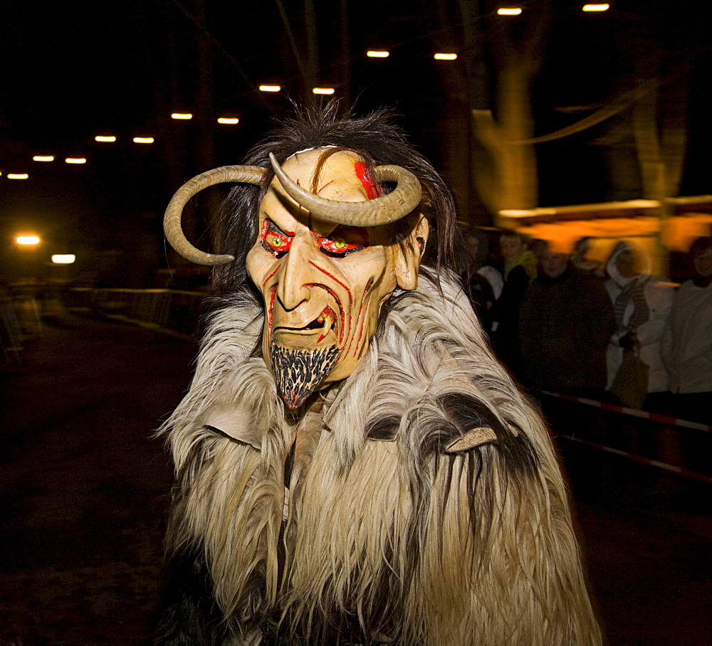 Krampus, a traditional Austrian figure bound to the tradition of St. Nicholas, he is the evil counterpart responsible for punishing and frightening the wicked children while St. Nicholas rewards the honest children, Reichenau at Mt. Rax, Lower Austria, Au