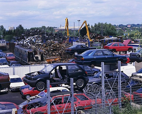 Wrecking yard, scrapyard, cars and electric locomotives, recycling, metal salvaging