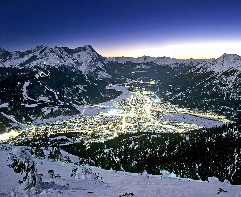 View from Mount Wank, night shot, Garmisch-Partenkirchen's town lights, Wetterstein Range, Werdenfels, Upper Bavaria, Bavaria, Germany