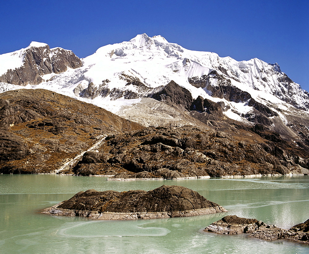 Mt. Huayna Potosi viewed from the reservoir at Zongo Pass, Cordillera Real, La Paz, the Andes, Bolivia