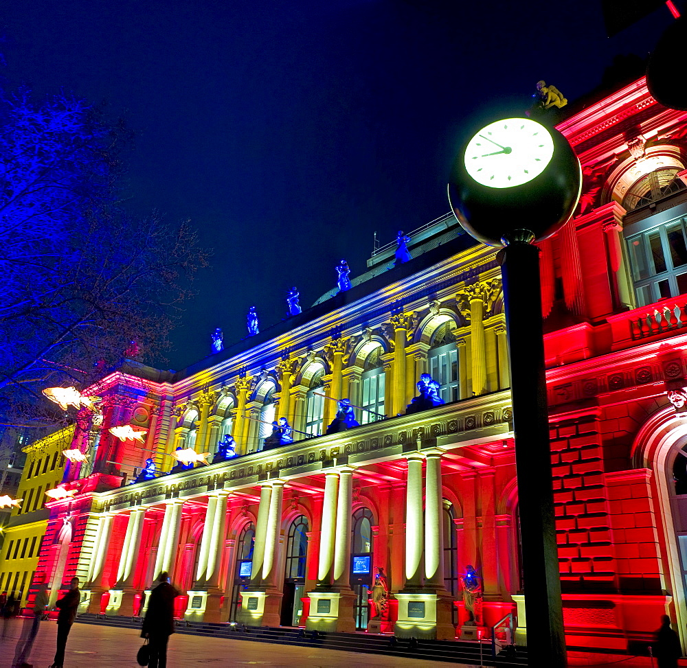 Frankfurt Stock Exchange at night, illuminated by multicoloured spotlights for the Luminale, biannual lighting festival in Frankfurt, Germany