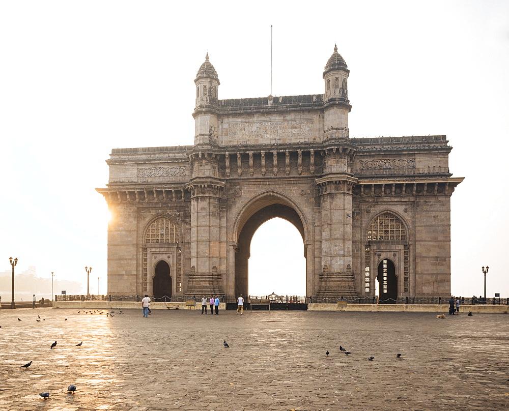 Sunrise behind The Gateway to India, Mumbai (Bombay), India, South Asia