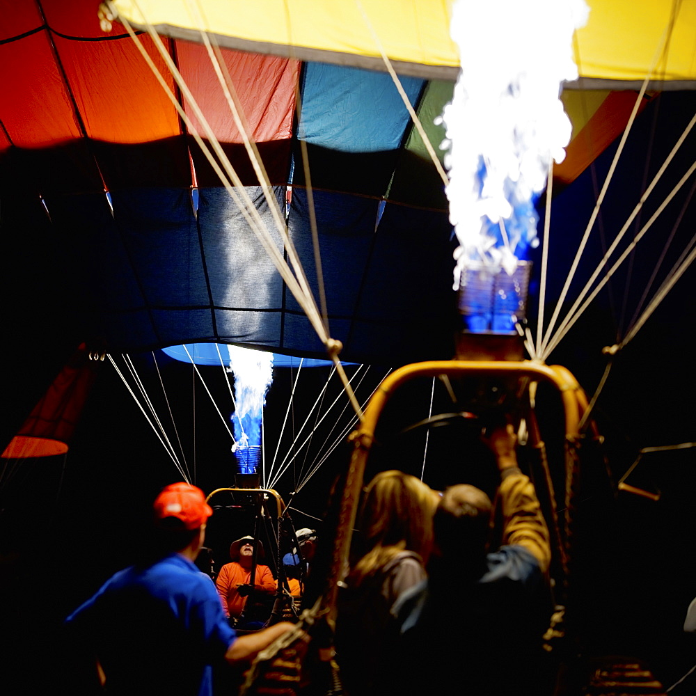 Gas burners inflating two balloons in the morning darkness at the Sonoma County Hot Air Balloon Classic. - 857-95052