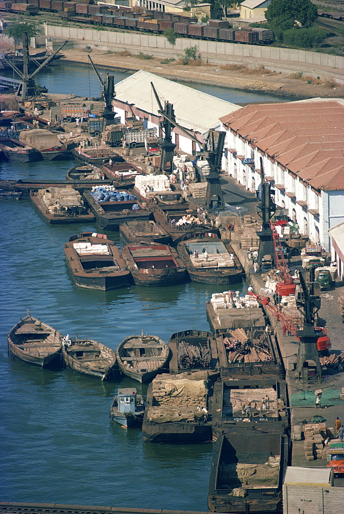 Boats and barges along the waterfront of the docks in Karachi, Pakistan, Asia