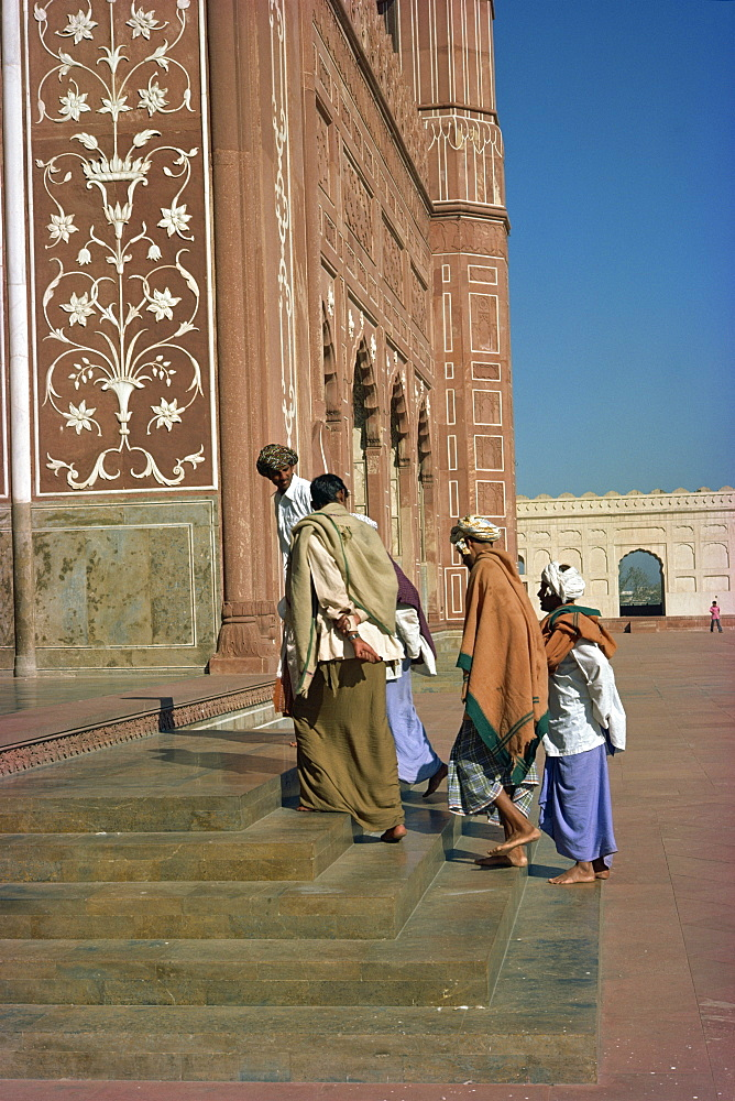 A group of men in the Badshahi mosque in Lahore, Pakistan, Asia