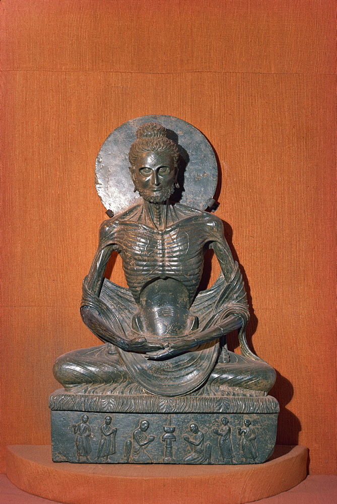 Statue of the fasting or emaciated Buddha in the Museum at Lahore, Pakistan, Asia