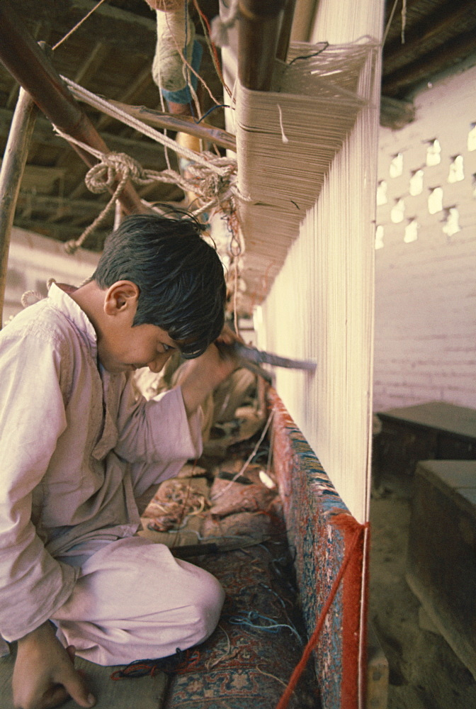 Child working in carpet factory in the 1970s, Lahore, Pakistan, Asia